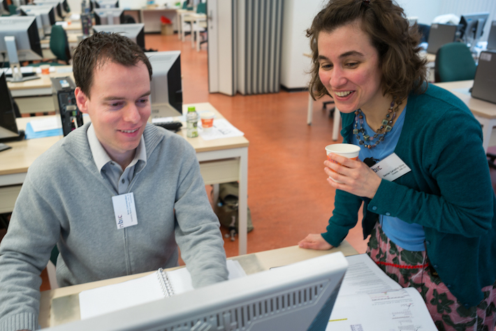 Helping  out a user during a workshop coffee break in the Netherlands